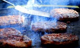 Hamburgers on the grill. Royalty Free Stock Photo