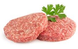 Hamburgers. Hamburger patties and parsley  on white background Stock Images