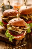 Hamburgers, homemade burgers with grilled buns with addition of addition of beef cutlet, lettuce, tomato,pickled cucumber, grille stock photography