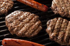 Hamburgers and Hot Dogs on the Grill Stock Photos