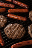 Hamburgers and Hot Dogs on the Grill Stock Photography