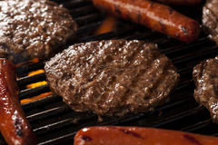 Hamburgers and Hot Dogs on the Grill Royalty Free Stock Photos
