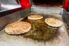 Hamburgers` patties . Royalty Free Stock Image
