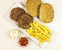 Hamburgers in a plate on white background Royalty Free Stock Images