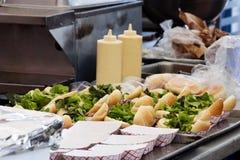 Hamburgers almost ready. Taste of Chicago - preparing hamburgers Royalty Free Stock Images