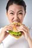 Hamburgeru zjadacz Obraz Royalty Free