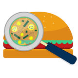 Hamburguer with bacteria. Magnifying glass showing bacteria on hamburguer. White background Stock Photo