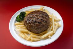 Hamburguer. Delicious hamburger plate with french fries and broccoli royalty free stock photography