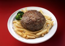 Hamburguer. Delicious hamburger plate with french fries and broccoli stock images