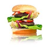 Hamburguesa doble con carne de vaca asada a la parrilla Foto de archivo libre de regalías