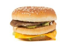 Hamburguesa grande aislada en blanco Imagen de archivo libre de regalías