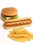 Hamburguesa, perrito caliente y patatas fritas Imagenes de archivo