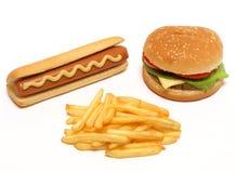 Hamburguesa, perrito caliente y patatas fritas fotografía de archivo libre de regalías