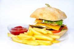 Hamburguesa y fritadas con la salsa de tomate Imagen de archivo libre de regalías