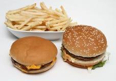 Hamburguesa y fritadas dobles Imagen de archivo libre de regalías