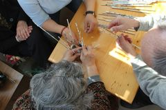 Hamd`s of elderly people during occupational therapy. And occupational therapist`s hands Stock Photos