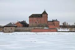 Hame城堡在海门林纳在冬天阴云密布天,芬兰 库存图片