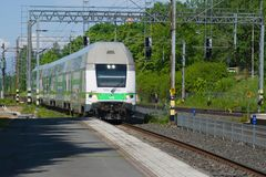 Modern double-Decker train coming to the platform of the railway station, Hameenlinna, Finland Stock Photos