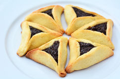 Hamentashen Ozen Haman Purim cookies. Six Backed Hamentashen, Ozen Haman, Purim cookies designed in Hexagon shape on a white plate for the Jewish holiday Purim Stock Photography