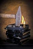 Hamer en brandende harde schijven Stock Afbeelding