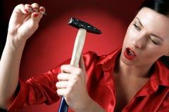 Hamer en spijker Stock Foto's