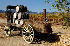 Hames Valley, CA: Wine Barrel Cart. An old cart laden with stacked hay bales and wooden wine barrels sits at the entrance to the Hames Valley Vineyards in Stock Image