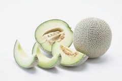 Hami-Kantalupenmelone mit Scheiben stockfotos