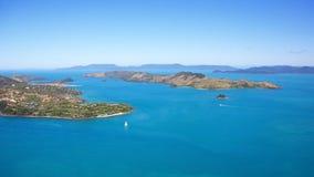 Hamilton Island Aerial Whitsundays Landscape. Aerial view of Hamilton Island and Dent Island Whitsundays. Clear blue sky and turquoise sea make perfect landscape Stock Photo