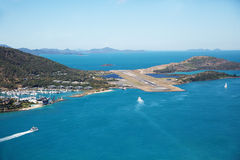 Hamilton Island Airport Runway. Aerial landscape of Hamilton Island Resort Airport runway, situated with blue sea and sky, Whitsundays, Australia Royalty Free Stock Photo