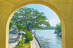 Hamilton`s Canal through the arch, Colombo. COLOMBO, SRI LANKA - DECEMBER 7, 2016: The arch of the bridge opens the view on the Hamilton`s Canal, branching from Royalty Free Stock Photography