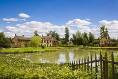 The Hamlet houses behind the lake Royalty Free Stock Photography