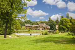 The Hamlet houses behind the pond Royalty Free Stock Image