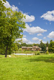 The Hamlet houses behind the pond Royalty Free Stock Photography