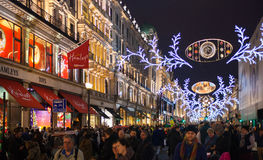 Hamley's toy store, Sales started in London. Regent street in Christmas lights. LONDON, UK - NOVEMBER 30, 2014: Black Friday weekend in London the first sale stock photos