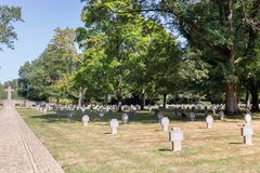 Monument and headstones at German WW2 Cemetery Sandweiler in Luxembourg. Hamm near Luxembourg city, Luxembourg - August 22, 2018: Memorial monument and royalty free stock photo