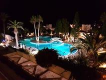 Hammamet, Tunesien - 25. Juli 2017: Touristen entspannen sich durch das Pool von Hotel Club Novostar Sol Azur Beach Congres Stockbild