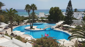 Hammamet, Tunisia - July 25, 2017: Tourists relax by the pool of hotel Club Novostar Sol Azur Beach Congres.  stock video