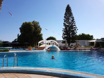 Hammamet, Tunisia - July 25, 2017: Tourists relax by the pool of hotel Club Novostar Sol Azur Beach Congres.  royalty free stock image