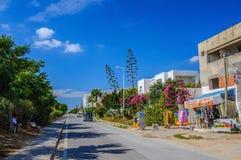HAMMAMET, TUNISIA - Oct 2014: Slum street with ruins on October 6, 2014 Stock Photos