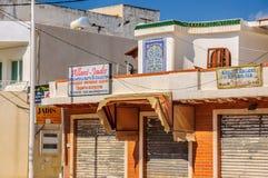 HAMMAMET, TUNISIA - Oct 2014: Slum street with ruins on October 6, 2014 Royalty Free Stock Photos