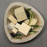 Hamman scenery : olive soap with black olives and leafs Stock Images