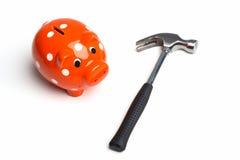 hammare med spargrisen Arkivfoto