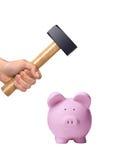 Hammer über einem rosa Sparschwein Stockfotos