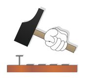 Hammer. Hand hammering nails with a hammer Royalty Free Stock Image