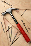 Hammer. And nails on wood boards Royalty Free Stock Photo