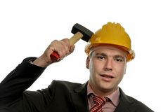 Hammer. Young male worker portrait with a hammer Royalty Free Stock Image