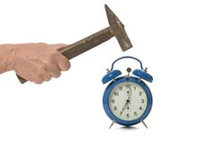 Hammer and alarm clock Stock Images