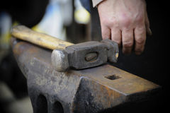 Hammer on anvil Royalty Free Stock Photos