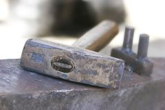 Hammer on anvil Stock Photography