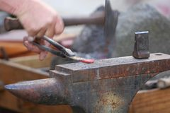 Hammer and anvil Stock Photography